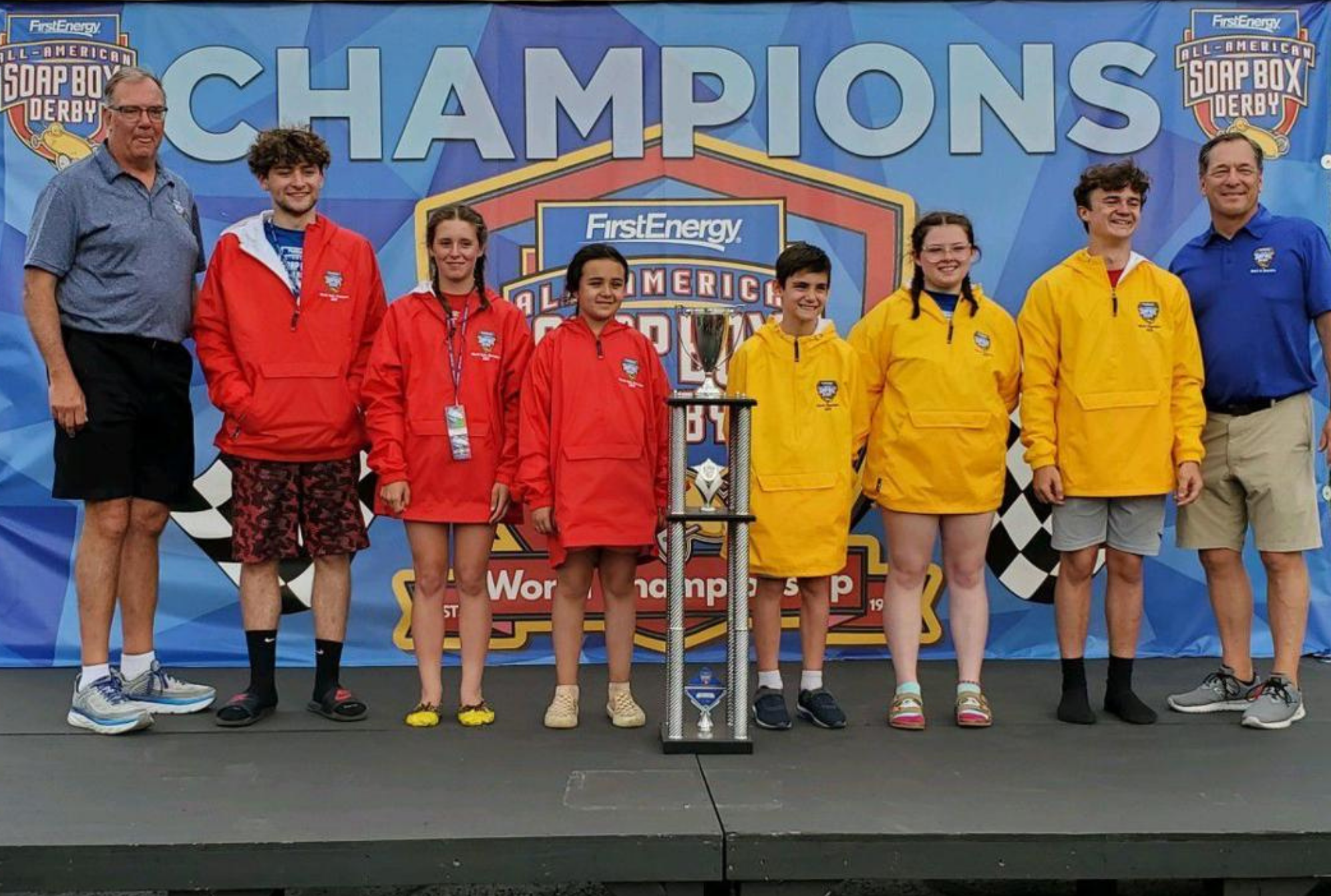 Bella Siddle, middle in the red jacket, poses with the five other division winners after the 83rd All-American Soap Box Derby, in Akron, Ohio, on Saturday, July 24, 2021.