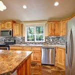 Maple cabinets and tile backsplash.