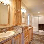 Maple cabinets in main bedroom ensuite bathroom with double sinks.